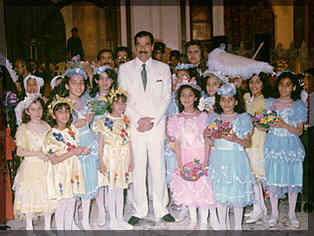 Sadam sourounded by little girls